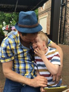 Autism, love and life ~ Andrew and Harry cuddle after a day out