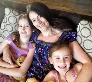 Our Autism stories - Steph and her girls cuddle on the sofa