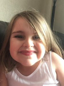 Our Autism stories _ Isla smiling at the camera