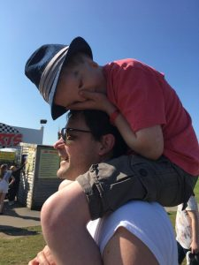 autism, love and life ~ Andrew with Harry on his shoulders at Presthaven sands