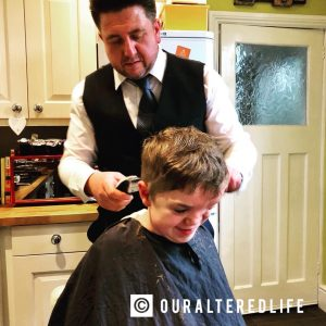 looking back - Harry smiles in my kitchen as his Dad cuts his hair