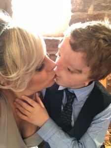looking back - harry gives me a kiss at my sisters wedding