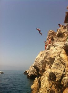 Andrew cliff jumping in Croatia