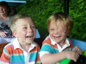 Oliver and Harry laughing on a ride in Devon in 2009