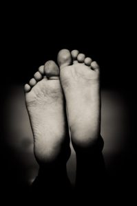 NHS heroes - the soles of two feet, a black and white image