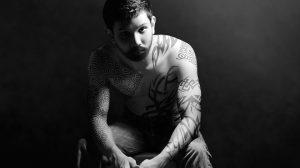 Tattoo or not tattoo - a man has a tattoo'd chest