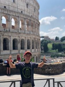 Visit Rome - Oliver outside the Colosseum