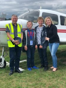 Young aviators day - Me, the boys and the pilot outside the plane