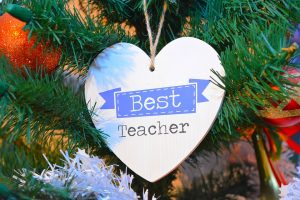 why i left teaching - a best teacher sign hangs on a christmas tree