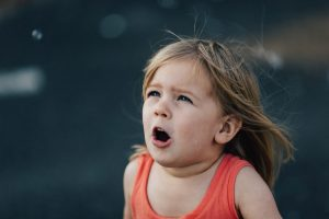 reasons for anger - a girl looks shocked, mouth and eyes wide open