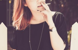 reasons for anger - a woman smokes a cigarette