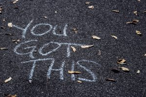 you've got this - you got this is written in chalk on a grey playground type floor
