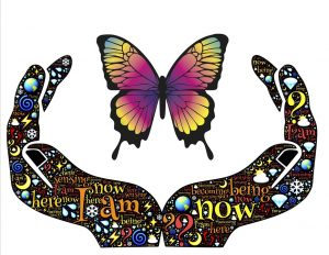 Hands with affirmations such as I am here and now, hold a butterfly