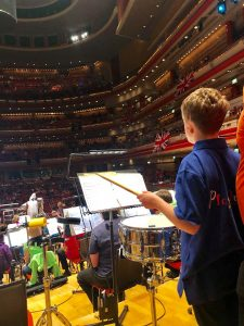 Harry playing drums at the symphony hall