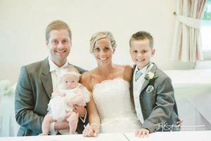 Laura with her husband, son and daughter on her wedding day