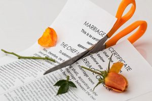 A marriage certificate gets cut up