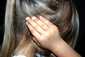 Life after Divorce - A young girl puts her hands to her ears