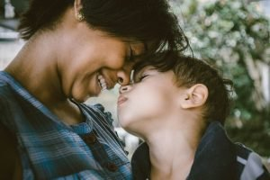 reducing anxiety in children - a mother cuddles up with her son