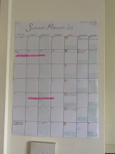 school holidays - a home made wall planner showing some key dates